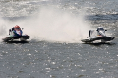 Formula One. Chris Fairchild (right) makes pass on Greg Foster to take the lead and on to victory